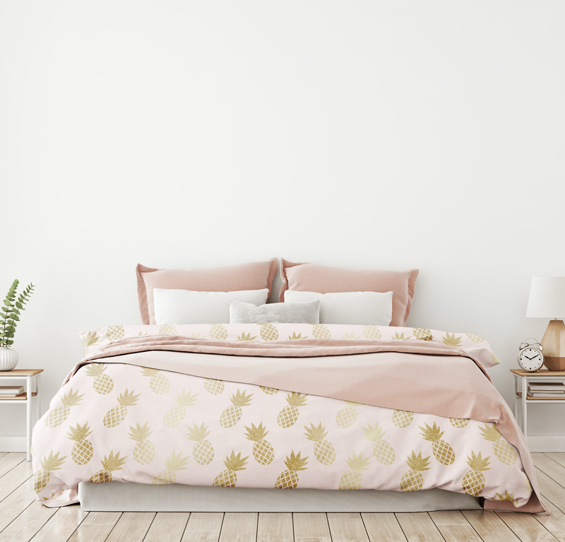 Pink and Gold Pineapple Pattern Comforter from Society6