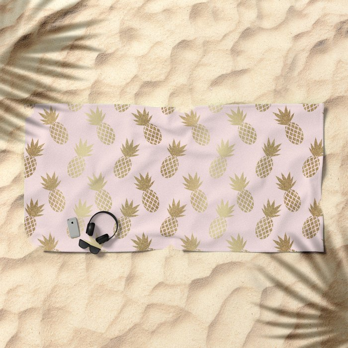 Pink and Gold Pineapple Pattern Beach Towel from Society6