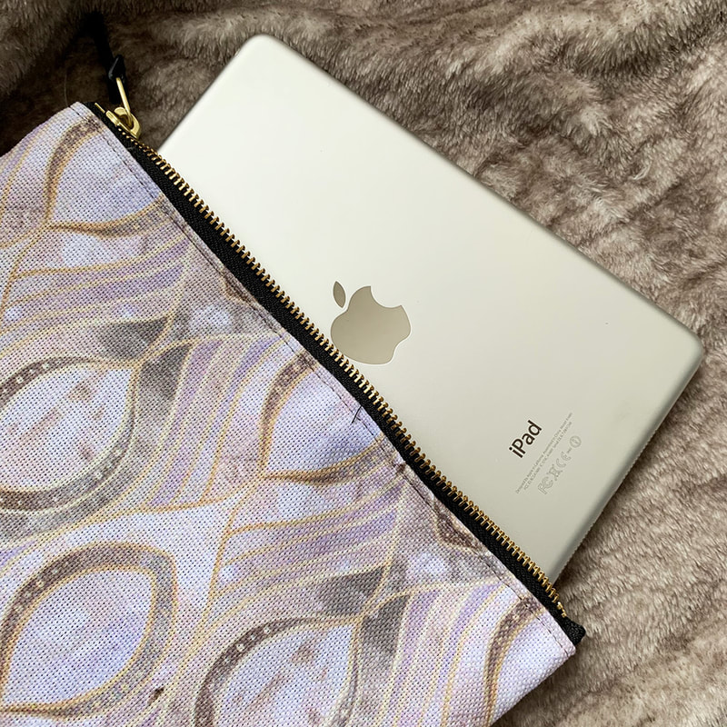 iPad mini inside a Society6 Carry All Pouch
